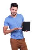 Casual man presenting a talbet pad screen Stock Image