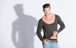 Casual man pulls his blouse Royalty Free Stock Photo