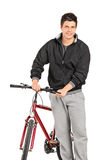 Casual man pushing a bicycle Royalty Free Stock Photos