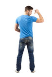 Casual man rear view pointing with thumb on his back Royalty Free Stock Image