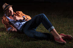 Casual man relaxing in the grass Royalty Free Stock Photography