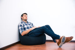 Casual man resting on the bag chair Stock Image