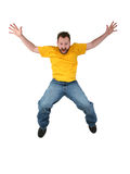 Casual Man Screaming And Falling. Man in yellow shirt and jeans falling and screaming over white.  Shot with the Canon 20D Royalty Free Stock Image