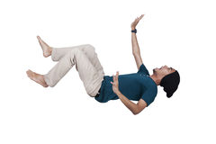 Casual man screaming and falling. Man in blue shirt and jeans falling and screaming pose over white Royalty Free Stock Photos