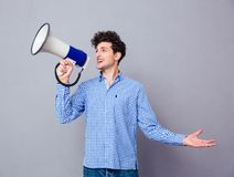 Casual man screaming on megaphone Royalty Free Stock Photo