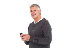 Casual man sending a text Royalty Free Stock Image