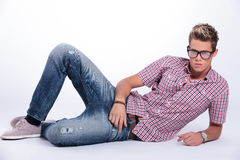 Casual man serious on the floor Stock Photography