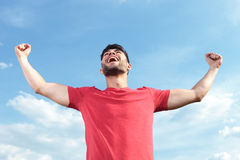 Casual man shouting victorious Royalty Free Stock Images