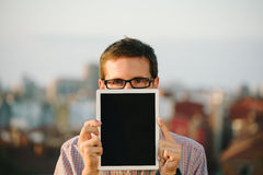 Casual man showing digital tablet blank screen Stock Photography