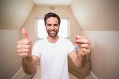 Casual man showing his house key Royalty Free Stock Images