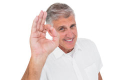 Casual man showing ok sign to camera. On white background stock photo