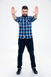 Casual man showing stop gesture with palms Royalty Free Stock Photo