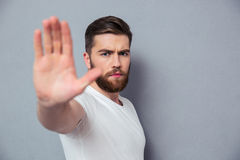 Casual man showing stop sign o Royalty Free Stock Image