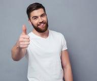 Casual man showing thumb up and loking at camera Royalty Free Stock Photography