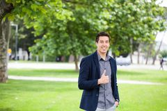 Casual Man Showing Thumbs Up And Smiling Royalty Free Stock Photo