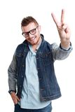 Casual man showing victory sign. Closeup of a young casual man showing victory sign on white background Stock Images