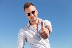 Casual man shows thumb up outdoor Royalty Free Stock Photo