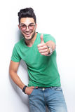 Casual man shows the thumbs up sign Stock Photo