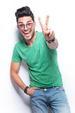 Casual man shows victory gesture Stock Photo