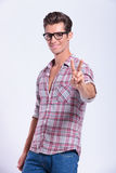 Casual man shows victory sign Royalty Free Stock Photography