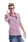 Casual man shows victory sign Royalty Free Stock Images