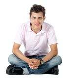 Casual man sitting Stock Images