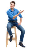 Casual man sitting Royalty Free Stock Photo