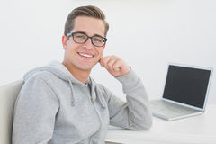 Casual man sitting at desk with laptop Royalty Free Stock Photography