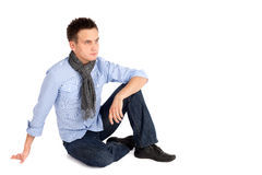 Casual Man Sitting on the ground Royalty Free Stock Images