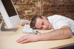 Casual man sleeping at his desk Royalty Free Stock Photo