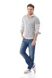 Casual man smiling. Casual young man in jeans and shirt smiling Royalty Free Stock Image