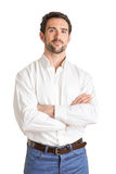 Casual Man. Casual  man smiling with arms crossed in a white background Stock Photo