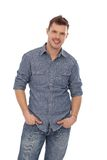 Casual man smiling with hands in pockets. Casual young man smiling with hands in pockets Royalty Free Stock Image