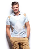 Casual man smiling with his hands in pockets Royalty Free Stock Image