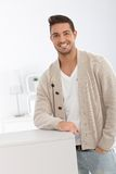 Casual man smiling at home Stock Photos