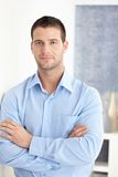 Casual man standing arms crossed smiling. Casual young man standing arms crossed, smiling Royalty Free Stock Photo