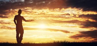 Man standing on sunset sky pointing right Royalty Free Stock Photography
