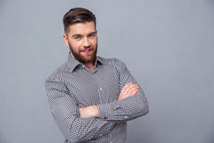 Casual man standing in shirt with arms folded Royalty Free Stock Photo