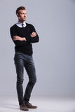 Casual man stands with hands folded Royalty Free Stock Image