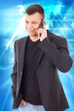 Casual man in a suit talking over mobile and smiling Royalty Free Stock Photo