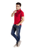 Casual man with t-shirt and jeans pointing at the camera Royalty Free Stock Image