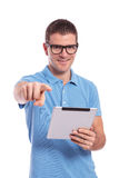 Casual man with tablet is pointing at you Stock Image