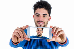 Casual man taking a selfie Royalty Free Stock Photos