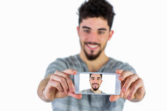 Casual man taking a selfie Stock Image