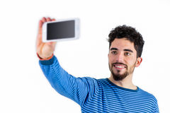 Casual man taking a selfie Royalty Free Stock Images