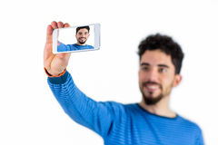 Casual man taking a selfie Royalty Free Stock Photography