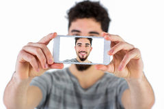 Casual man taking a selfie Royalty Free Stock Photo