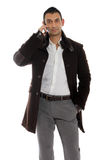 Casual man talking on the phone. Casual man talking on his cellular phone Royalty Free Stock Image