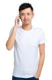 Casual man talking on phone Stock Photos