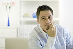 Casual man thinking Royalty Free Stock Photo